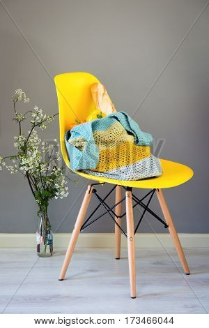Knitted Woolen Hand Bag On Yellow Chair