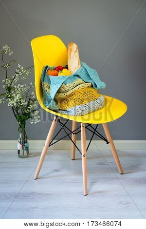 Handcrafted Woolen Hand Bag On Yellow Chair