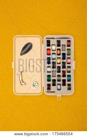 Different Color Thread In Bobbins And Other Sewing Machine Parts