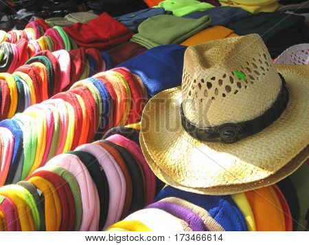 Hats and tuques being offered at a market
