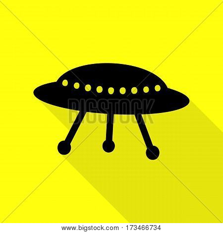 UFO simple sign. Black icon with flat style shadow path on yellow background.