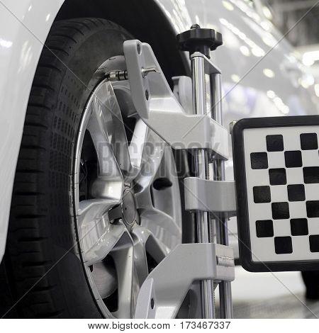 Wheel alignment equipment on a car
