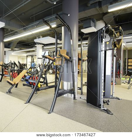 Interior of a modern fitness hall with a bench
