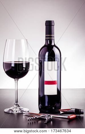 Red Wine Bottle And Glass With Wine Tools