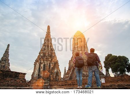 Traveler man and women with backpack walking in temple Ayuttaya Thailand soft and select focus