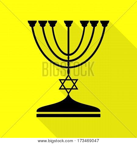 Jewish Menorah candlestick in black silhouette. Black icon with flat style shadow path on yellow background.