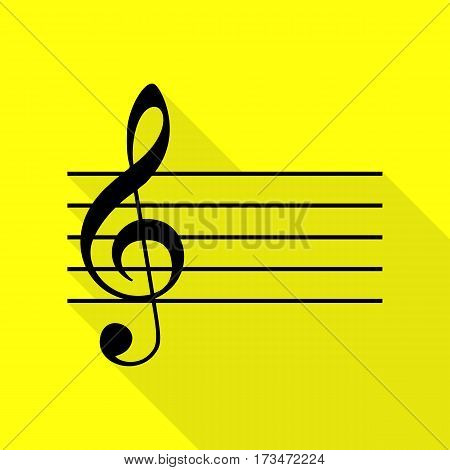 Music violin clef sign. G-clef. Black icon with flat style shadow path on yellow background.