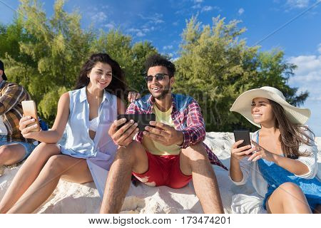 Young People Group On Beach Using Cell Smart Phone Summer Vacation, Happy Smiling Friends Chatting Online Holiday Travel