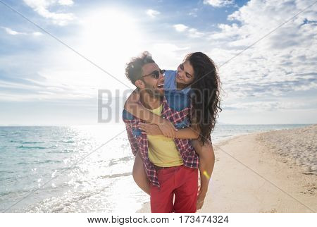 Young Couple On Beach Summer Vacation, Happy Smiling Man Carry Woman Back Seaside Sea Ocean Holiday Travel