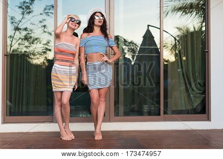 Young Girl Couple On Terrace Tropical Hotel, Two Beautiful Woman Tropic Holiday Vacation Green Forest