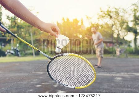 Father and son playing badminton.Family with activity.