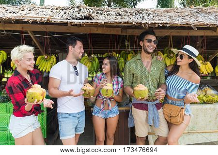 People Group Drink Coconut Cocktail Asian Fruits Street Market Buying Fresh Food, Young Friends Tourists Exotic Vacation Tropical Holiday