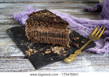 chocolate cake with tea and coffee beans