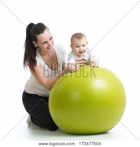 kid and mother play on fitness ball