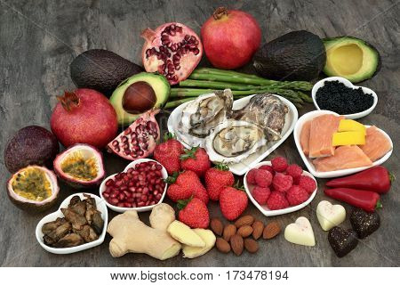 Large aphrodisiac food selection for good sexual health over marble background.