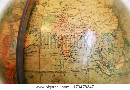 Scenery with India of the old terrestrial globe