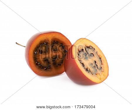 Sliced tamarillo fruit composition isolated over the white background