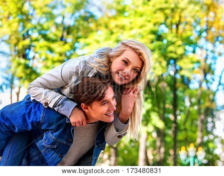 Adventure trips for couples. Spring people walking park and kissing. Summer friends walk outdoor. Weekends first date of two young person in good weather day.
