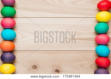 Frame Easter Colored Eggs With A Wooden Background