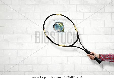 Racket in person hand . Mixed media
