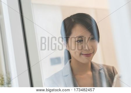 young Asian business woman read text on mobile phone