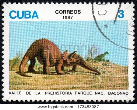 UKRAINE - CIRCA 2017: A stamp printed in Cuba shows a Cuban crocodile Crocodylus rhombifer the series Prehistoric animals circa 1982
