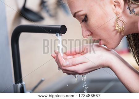 Woman Drinking Water With Her Hands