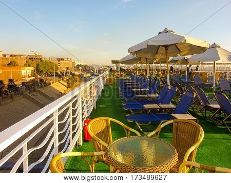 Watching sunrise standing on Egyptian cruise ship upper deck