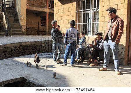Yuanyang, China - February 20, 2017: Hani Family, One Of The 56 Minorities In China, Spending Some T