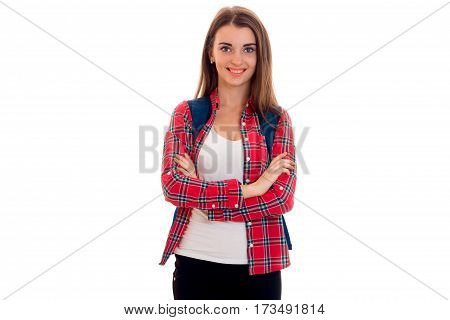 a young girl in a Plaid Shirt stands idly by and smiling isolated on white background