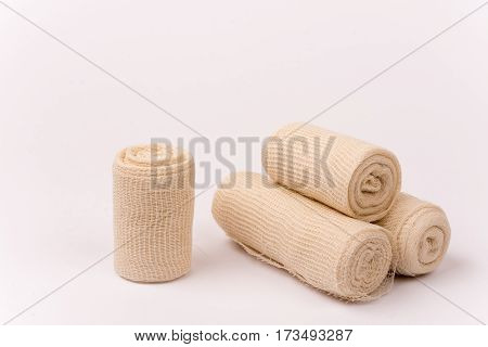 Bunch Of New Bandage Rolls Over White Background