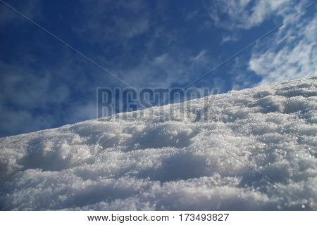 white snow on mountain against the blue sky low angle view