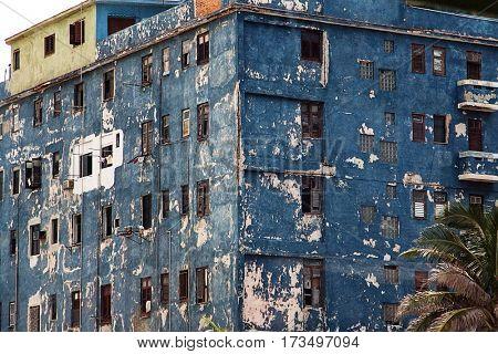 Havana, Cuba, July, 11, 2006. - Cracked paint on a blue wall in old Havana city. Many buildings need to be fixed in Havana.