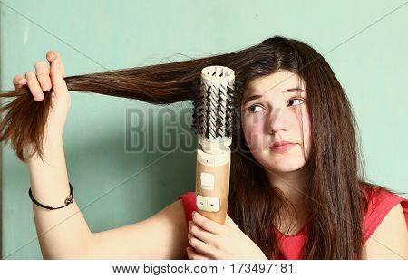Teen Girl Straighten Her Long Brown Hair