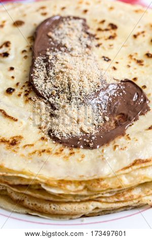 Pancakes With Nutella Cream And Grated Biscuits