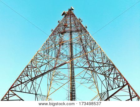 Telecommunication tower in the beautiful clear sky background.
