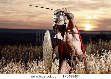 Sepia toned shot of a Roman legionary soldier fighting with his sword copyspace warzone combat attack weapon concept