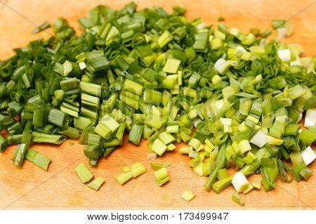 Fresh Green Onions On A Cutting Board.