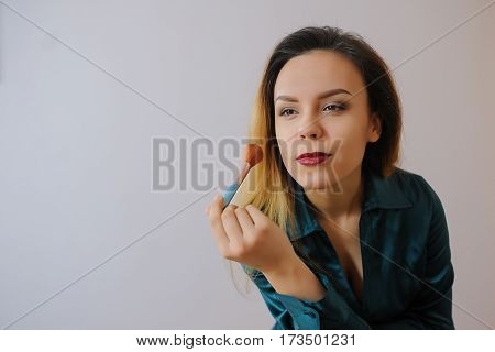 Woman Applying Foundation Blusher With Makeup Brush