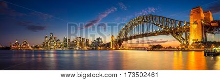 Sydney. Panoramic image of Sydney, Australia with Harbour Bridge during twilight blue hour.