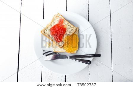 Toast With Strawberry And Orange Yam On Plate