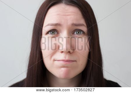 Girl looks pleadingly up, hoping for help