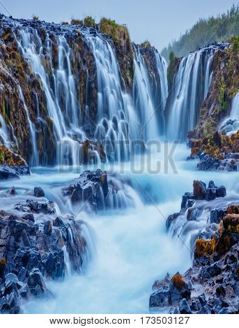 Dramatic views of the powerful Bruarfoss waterfall. Popular tourist attraction. Unusual and picturesque scene. Location place South Iceland, Europe. Artistic picture. Discover the world of beauty.