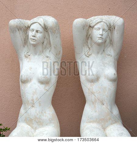 Statues of two beautiful women in Lazise on Lake Garda. Italy