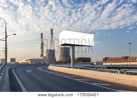 Empty billboard and road turn with thermoelectric plant on the background