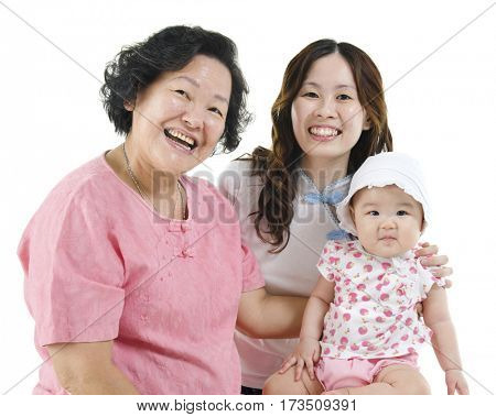 Portrait of happy three generations Asian family, grandmother, mother and grandchild, isolated on white background.