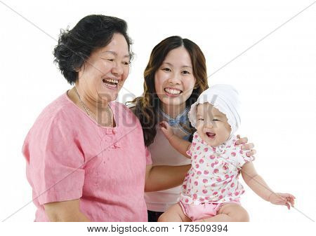 Portrait of happy three generations Asian family, senior woman, adult daughter and baby girl, isolated on white background.