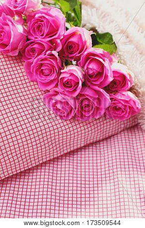 a bunch of pink roses on pillow - love is in the air