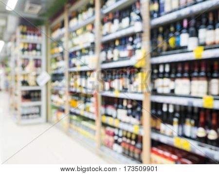 Abstract blurred supermarket colorful shelves with alcohol, champagne, wine bottles as background