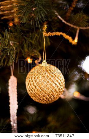 Christmas tree decorated with garlands, ball , sweet and Christmas lights on the background of beautiful bokeh.